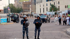Iraqi security forces close a bridge leading to the heavily guarded Green Zone during a campaign rally of followers of Shiite cleric Muqtada al-Sadr in Tahrir Square, Baghdad, Iraq, Friday, May 4, 2018. (AP Photo/Karim Kadim)