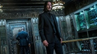 """This image released by Lionsgate shows Keanu Reeves in a scene from """"John Wick: Chapter 3 - Parabellum."""" The third installment of the hyper violent Keanu Reeves franchise has taken the top spot at the North American box office and ending the three-week reign of """"Avengers: Endgame.,"""" Studios on Sunday, May 19, 2019, say """"John Wick: Chapter 3 - Parabellum"""" has grossed an estimated $57 million in its opening weekend.  (Niko Tavernise/Lionsgate via AP)"""