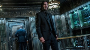 "This image released by Lionsgate shows Keanu Reeves in a scene from ""John Wick: Chapter 3 - Parabellum."" The third installment of the hyper violent Keanu Reeves franchise has taken the top spot at the North American box office and ending the three-week reign of ""Avengers: Endgame.,"" Studios on Sunday, May 19, 2019, say ""John Wick: Chapter 3 - Parabellum"" has grossed an estimated $57 million in its opening weekend.  (Niko Tavernise/Lionsgate via AP)"