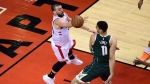 Toronto Raptors centre Marc Gasol (33) throws the ball away under pressure from Milwaukee Bucks centre Brook Lopez (11) during the second half of Game 3 NBA Eastern Conference finals basketball action in Toronto on Sunday, May 19, 2019. THE CANADIAN PRESS/Frank Gunn