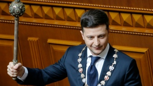Ukrainian new President Volodymyr Zelenskiy holds a mace, the Ukrainian symbol of power, during his inauguration ceremony in Kiev, Ukraine, Monday, May 20, 2019. Ukrainian television star Volodymyr Zelenskiy has been sworn in as president and immediately disbanded the Ukrainian parliament. That was one of his campaign promises, for Zelenskiy had branded the body as a group only interested in self-enrichment. (AP Photo/Efrem Lukatsky)
