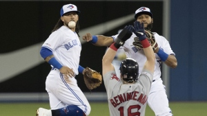 Boston Red Sox Andrew Benintendi is out on the force out at second base as Toronto Blue Jays second baseman Richard Urena tries to turn the double play and shortstop Freddy Galvis looks on during the third inning of their American League MLB baseball game in Toronto, Monday, May 20, 2019. THE CANADIAN PRESS/Fred Thornhill