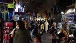 People walk at a traditional bazaar south of Tehran, Iran, Wednesday, May 8, 2019. Iran threatened Wednesday to enrich its uranium stockpile closer to weapons-grade levels in 60 days if world powers fail to negotiate new terms for its 2015 nuclear deal, raising regional tensions as a U.S. aircraft carrier and bombers headed to the Middle East to confront Tehran. (AP Photo/Vahid Salemi)
