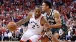 Toronto Raptors forward Kawhi Leonard (2) drives to the net around Milwaukee Bucks guard Malcolm Brogdon (13) during the second overtime period of Game 3 NBA Eastern Conference finals basketball action in Toronto on Sunday, May 19, 2019. THE CANADIAN PRESS/Nathan Denette
