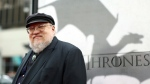 """In this March 18, 2013 file photo, author George R.R. Martin arrives at the premiere for the third season of the HBO television series """"Game of Thrones"""" at the TCL Chinese Theatre in Los Angeles. Random House announced Wednesday that a prequel to the """"Ice and Fire"""" series is coming out November 20. The book is called """"Fire and Blood"""" and it's the first of two planned works that the publisher is calling """"the definitive history of the Targaryens in Westeros'"""" (Photo by Matt Sayles /Invision/AP, File)"""