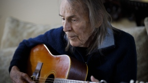 Canadian musician Gordon Lightfoot strums his guitar in his Toronto home on Thursday, April 25, 2019. THE CANADIAN PRESS/Cole Burston