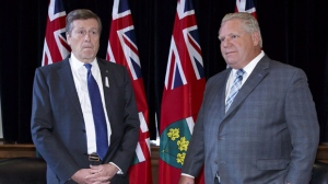Toronto Mayor John Tory, left, and Ontario Premier Doug Ford stand for a photo opp in Ford's Queen's Park office in Toronto on December 6, 2018. Ontario's municipalities say they may be forced to raise taxes or cut services due to provincial government cuts that will likely equal well over half a billion dollars in lost annual funding and foregone revenue. THE CANADIAN PRESS/Cole Burston