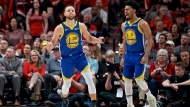 Golden State Warriors guard Stephen Curry, left, and guard Quinn Cook react after Curry made a basket against the Portland Trail Blazers during the second half of Game 4 of the NBA basketball playoffs Western Conference finals Monday, May 20, 2019, in Portland, Ore. The Warriors won 119-117 in overtime. (AP Photo/Craig Mitchelldyer