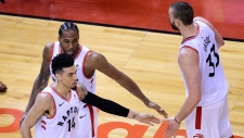 Toronto Raptors guard Danny Green (14) forward Kawhi Leonard (2) and centre Marc Gasol (33) celebrate following their win against the Milwaukee Bucks in Game 3 of the NBA Eastern Conference finals in Toronto on Sunday, May 19, 2019. THE CANADIAN PRESS/Frank Gunn