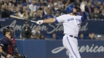 Toronto Blue Jays' Rowdy Tellez hits a three run home run against the Boston Red Sox in the fifth inning of their American League MLB baseball game in Toronto on Tuesday May 21, 2019. It was his second home run in the game. (THE CANADIAN PRESS/Fred Thornhill)