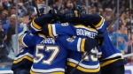 St. Louis Blues players celebrate after Tyler Bozak scored against the San Jose Sharks during the third period in Game 6 of the NHL hockey Stanley Cup Western Conference final series Tuesday, May 21, 2019, in St. Louis. (AP Photo/Jeff Roberson)