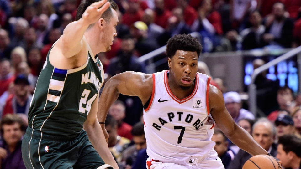 Toronto Raptors guard Kyle Lowry (7) drives for the basket as Milwaukee Bucks guard Pat Connaughton (24) defends during second half action in Game 4 of the NBA Eastern Conference final in Toronto on Tuesday, May 21, 2019. THE CANADIAN PRESS/Frank Gunn