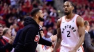 Drake congratulates Toronto Raptors forward Kawhi Leonard (2) as he leaves the court with three minutes left in the in second half action in Game 4 of the NBA Eastern Conference final against the Milwaukee Bucks in Toronto on Tuesday, May 21, 2019. The Raptors defeat the Bucks 120-102. THE CANADIAN PRESS/Frank Gunn