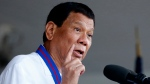 """FILE - In this April 19, 2018, file photo, Philippine President Rodrigo Duterte addresses troops during the turnover-of-command ceremony for the new chief of the Philippine National Police General Oscar Albayalde succeeding General Ronald """"Bato"""" Dela Rosa at Camp Crame in suburban Quezon city northeast of Manila, Philippines. (AP Photo/Bullit Marquez, File)"""
