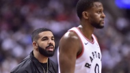 Canadian rapper Drake looks from courtside as the Toronto Raptors take on the Washington Wizard during first half game five of round one NBA playoff basketball action in Toronto on Wednesday, April 25, 2018. THE CANADIAN PRESS/Frank Gunn