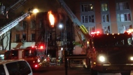 Crews are shown battling a fire at a heritage property on Dundas Street West early Thursday morning. (Mike Nguyen)