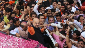 India's ruling Bharatiya Janata Party (BJP) President Amit Shah displays the victory sign as he arrives at the party office in new Delhi, India, Thursday, May 23, 2019. Indian Prime Minister Narendra Modi's party claimed it had won reelection with a commanding lead in Thursday's vote count, while the stock market soared in anticipation of another five-year term for the pro-business Hindu nationalist leader. (AP Photo/Manish Swarup)