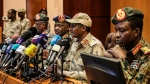 In this April 30, 2019 file photo, Gen. Mohamed Hamdan Dagalo, the deputy head of the military council, second right, speaks at a press conference in Khartoum, Sudan. (AP Photo)
