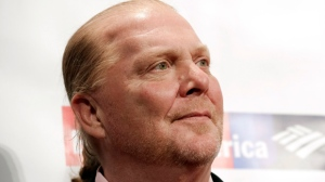 In this Wednesday, April 19, 2017, file photo, chef Mario Batali attends an awards event in New York. The Suffolk County District Attorney's Office in Boston says Batali is scheduled to be arraigned Friday, May 24, 2019, on a charge of indecent assault and battery, in connection with an allegation that he forcibly kissed and groped a woman at a Boston restaurant in 2017. (Photo by Brent N. Clarke/Invision/AP, File)