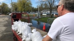 Residents are shown moving sandbags on the Toronto Islands on Friday morning. (Sean Leathong)