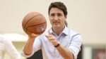 Prime Minister Justin Trudeau attends a basketball clinic with local youth, hosted by President of the Toronto Raptors Masai Ujiri in Toronto on Saturday, April 6, 2019. THE CANADIAN PRESS/Chris Young