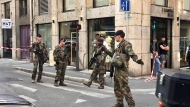 "Soldiers of French anti terrorist plan ""Vigipirate Mission"", secure the area near the site of a suspected bomb attack in central Lyon, Friday May, 24, 2019. (AP Photo/Sebastien Erome)"