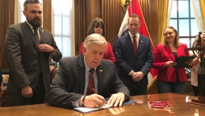 Missouri Gov. Mike Parson signs one of the nation's most restrictive abortion bills, banning the procedure on or beyond eight weeks of pregnancy, Friday, May 24, 2019 in Jefferson City, Mo. (AP Photo by Summer Balentine)