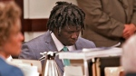 Emanuel Kidega Samson sits in court as the verdict is read in his murder trial Friday, May 24, 2019, in Nashville, Tenn. Samson was found guilty of first-degree murder in a shooting at a Nashville church two years ago that left a woman dead and seven wounded. Jurors deliberated less than five hours before finding Samson guilty on all 43 counts in the indictment. (Shelley Mays/The Tennessean via AP, Pool)