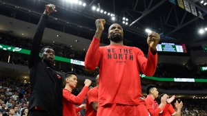 Toronto Raptors centre Serge Ibaka, centre, and Toronto Raptors forward Chris Boucher, left, react as teammate Toronto Raptors centre Marc Gasol makes a free throw during late second half action in Game 5 of the NBA Eastern Conference final in Milwaukee against the Milwaukee Bucks on Thursday, May 23, 2019. THE CANADIAN PRESS/Frank Gunn