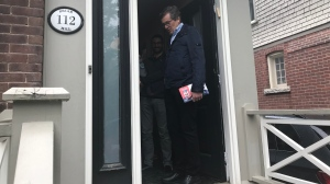 Mayor John Tory is shown going door-to-door in the Eglinton-Lawrence riding on Saturday as he stepped up his campaign against millions of dollars in provincial cuts. (Brandon Gonez)