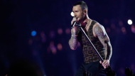 "In this Feb. 3, 2019 file photo, Adam Levine, of Maroon 5, performs during halftime of the NFL Super Bowl 53 football game between the Los Angeles Rams and the New England Patriots in Atlanta. Levine is leaving NBC's ""The Voice"" after 16 seasons. Carson Daly made the announcement Friday morning, May 24 on the ""Today"" show. Daly said Gwen Stefani will return for season 17 in Levine's chair. (AP Photo/Mark Humphrey, File)"