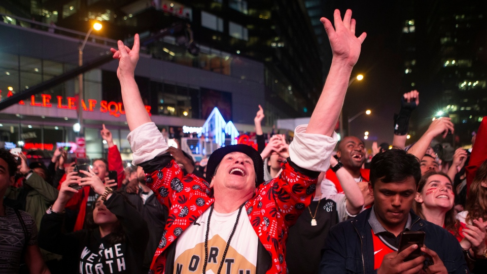 Toronto Raptors fans celebrate in the closing seconds of the team's 100-94 win over the Milwaukee Bucks to take the NBA Eastern Conference Championship, in Toronto on Saturday, May 25, 2019. The Raptors go to the NBA final for the first time in the franchise's history. THE CANADIAN PRESS/Chris Young