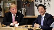 Japan Prime Minister Shinzo Abe, right, speaks during dinner with U.S. President Donald Trump at the Inakaya restaurant in the Roppongi district of Tokyo, Sunday, May 26, 2019. (Kiyoshi Ota/Pool Photo via AP)