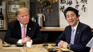 Japan Prime Minister Shinzo Abe, right, speaks during dinner with U.S. President Donald Trump at the Inakaya restaurant in the Roppongi district of Tokyo, Sunday, May 26, 2019. (Kiyoshi Ota/Pool Photo via AP)