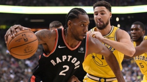 Toronto Raptors forward Kawhi Leonard (2) moves pass Golden State Warriors guard Klay Thompson (11) during first half NBA basketball action in Toronto on Thursday Nov. 29, 2018. THE CANADIAN PRESS/Nathan Denette