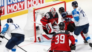 Finland's Marko Anttila (12) scores his second goal of the game against Canada goaltender Matt Murray (30) during the Ice Hockey World Championships gold medal match at the Ondrej Nepela Arena in Bratislava, Slovakia, Sunday, May 26, 2019. (AP Photo/Petr David Josek)