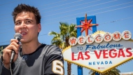 """In this May 2, 2019, file photo, """"Jeopardy!"""" sensation James Holzhauer speaks after being presented with a key to the Las Vegas Strip in front of the Welcome to Fabulous Las Vegas sign in Las Vegas. Holzhauer's """"Jeopardy"""" winning streak is still going and he may be track to surpass Ken Jennings' record earnings in the next month. (Caroline Brehman/Las Vegas Review-Journal via AP, File)"""