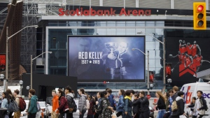 Pedestrians cross a busy Toronto street outside the Scotiabank Arena in Toronto, Friday, May 10, 2019. THE CANADIAN PRESS/Cole Burston