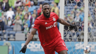 Toronto FC forward Jozy Altidore celebrates after he scored a goal against Seattle Sounders goalkeeper Stefan Frei, right, during the first half of an MLS soccer match in Seattle on April 13, 2019. (AP / Ted S. Warren)