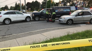 Police are seen attending to damaged cars at the scene of a collision on Dundas Street West in Mississauga on May 31, 2019. (Phil Fraboni/CTV News Toronto)
