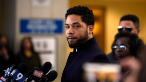 FILE - In this March 26, 2019 file photo, Actor Jussie Smollett talks to the media before leaving Cook County Court after his charges were dropped, in Chicago. (AP Photo/Paul Beaty, File)