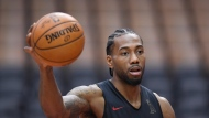Toronto Raptors forward Kawhi Leonard holds a basketball during a team practice for the NBA Finals in Toronto on Saturday, June 1, 2019. THE CANADIAN PRESS/Nathan Denette