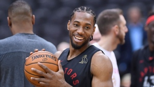 Toronto Raptors forward Kawhi Leonard smiles during a team practice for the NBA Finals in Toronto on Saturday, June 1, 2019. THE CANADIAN PRESS/Nathan Denette