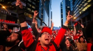 "Toronto Raptors fans watch Game 2 of the NBA Finals between the Raptors and the Golden State Warriors the in the fan area known as ""Jurassic Park"" outside Scotiabank Arena in Toronto on Sunday, June 2, 2019. THE CANADIAN PRESS/Chris Young"