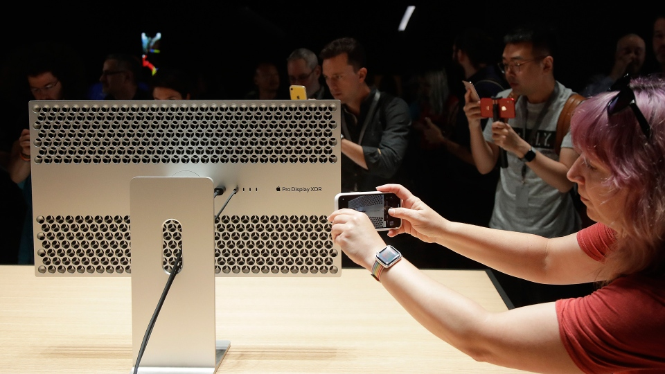 People take pictures of the Mac Pro in the display room at the Apple Worldwide Developers Conference in San Jose, Calif., Monday, June 3, 2019. (AP Photo/Jeff Chiu)