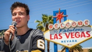 """In this May 2, 2019, file photo, """"Jeopardy!"""" sensation James Holzhauer speaks after being presented with a key to the Las Vegas Strip in front of the Welcome to Fabulous Las Vegas sign in Las Vegas. (Caroline Brehman/Las Vegas Review-Journal via AP, File)"""