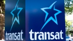 An Air Transat sign is seen in Montreal on May 31, 2016. Quebec real estate developer Group Mach Inc. has made a takeover offer for Transat AT Inc. worth $14 per share in cash. The offer comes after Transat announced last month it was in exclusive talks to be acquired by Air Canada for $13 per share. THE CANADIAN PRESS/Paul Chiasson