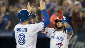 Toronto Blue Jays' Freddy Galvis is met at home plate by teammate Cavan Biggio after Galvis drove him in with a two-run home run in fifth inning of American League MLB baseball action against the New York Yankees, in Toronto on Tuesday, June 4, 2019. THE CANADIAN PRESS/Fred Thornhill