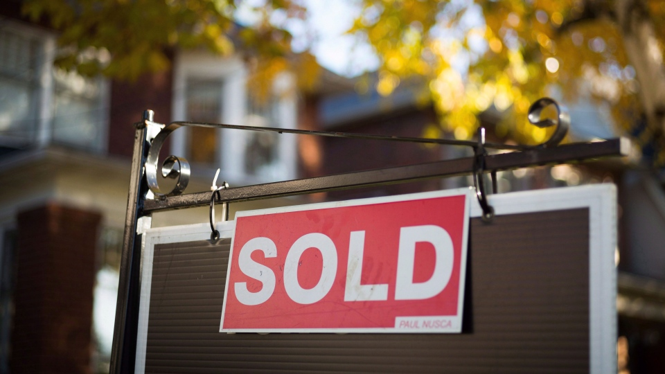 A sold sign in Toronto is seen in this file image. (Graeme Roy/The Canadian Press)
