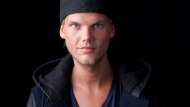 In this Aug. 30, 2013, file photo, Swedish DJ, remixer and record producer Avicii poses for a portrait in New York. Avicii was so invested and excited about his new album that even on his flight to Oman, where he later died, he was communicating with his producers about different sounds he wanted to include on the album. (Photo by Amy Sussman/Invision/AP, File)